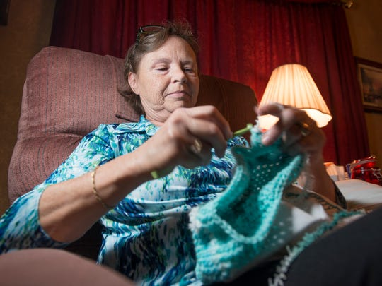 Bonnie Coleman crochets a hat Thursday, Sept. 28, 2017, at home in Milton. Coleman is donating the hats to The Studer Family Children's Hospital at Sacred Heart.