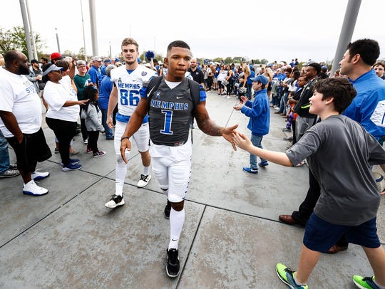 Tony Pollard (right) and Joey Magnifico greet fans during Tiger Walk before the Memphis spring football game at Liberty Bowl Memorial Stadium.