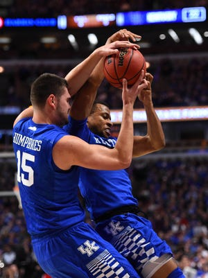 Nov 17, 2015; Chicago, IL, USA; Kentucky Wildcats guard Isaiah Briscoe (13) and forward Isaac Humphries (15) attempt to get a loose ball against the Kentucky Wildcats during the first half  at United Center. Mandatory Credit: Mike DiNovo-USA TODAY Sports