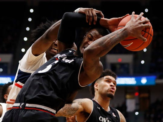 Cincinnati Bearcats guard Trevor Moore  works for the