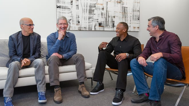 At Apple headquarters on Wednesday, from left: Jimmy Iovine; Apple CEO Tim Cook; Dr. Dre; and Apple's Eddy Cue.