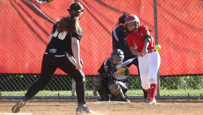 North Rockland's Victoria Alonso hita a double in the seventh inning of a game with Clarkstown South at North Rockland May 15, 2017. North Rockland won 2-1.