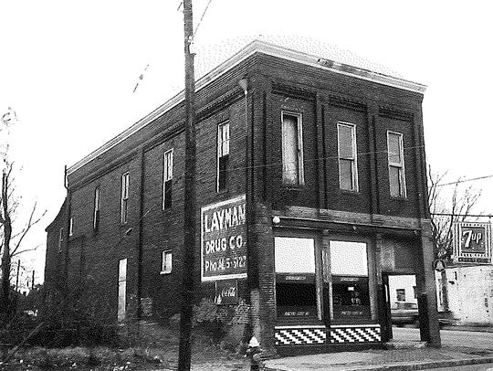 A photo from 1976 of the Layman Drug Building  in Chestnut