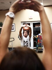 Reporter Patrick Riley takes a Tai Chi class instructed by Danli Neilson at Absolute Physical Therapy in Bonita Springs on Thursday, Nov. 12, 2015.
