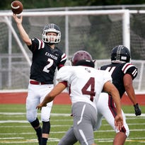 Elmira's quarterback Anthony Aumick throws down the field during an 80-8 win over Central Square earlier this season.