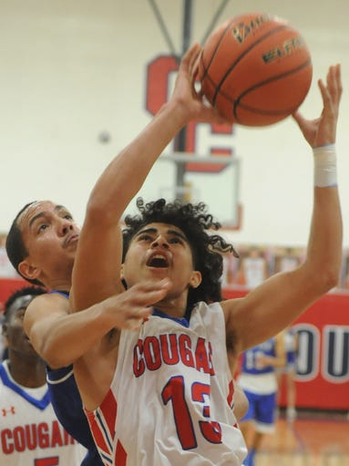 Cooper's Noah Garcia (13) is fouled by a San Angelo