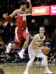 Alabama forward Braxton Key (25) sails past Vanderbilt guard Riley LaChance (13) in the first half of an NCAA college basketball game Tuesday, Jan. 2, 2018, in Nashville, Tenn. (AP Photo/Mark Humphrey)