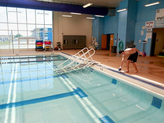 Facing a $1.3 million budget shortfall, Bloomfield City Council has opted to implement pay cuts for employees, as well as cut back on operating hours at the Bloomfield Family Aquatic Center.