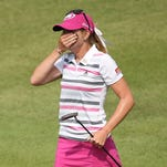 Paula Creamer reacts after holing a 75-foot eagle putt to seal victory in a playoff against Azahara Munoz in Singapore.
