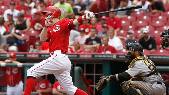 Cincinnati Reds' Todd Frazier follows through on a two-run home run off Pittsburgh Pirates pitcher Vance Worley in the sixth inning.
