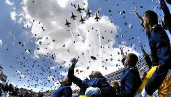 U.S. Air Force Academy graduates throw their hats in the air as the Thunderbirds fly overhead signaling the end of the Air Force Academy graduation ceremony, Colorado Springs, Colorado. The military offers many options to graduating seniors.