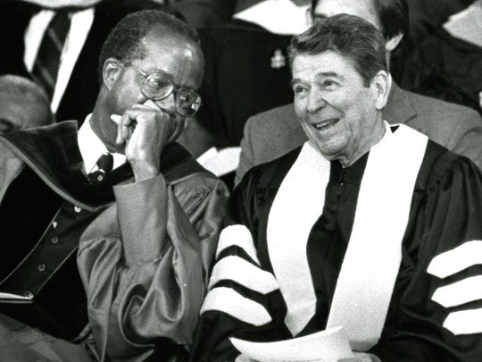 Tuskegee University president Benjamin Payton, left, chats with Ronald Reagan before Reagan delivers the commencment address at the university on May 10, 1987 (Montgomery Advertiser / Mickey Welsh)