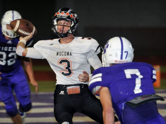 Nocona Indians quarterback Jeremy James throws under