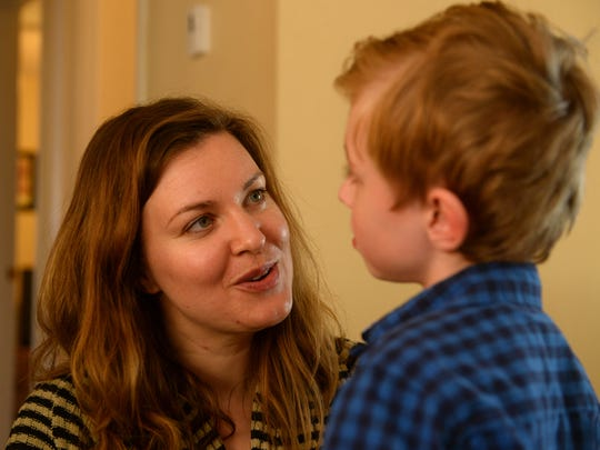 Jessi Bennion talks with her son Jack, who is in kindergarten