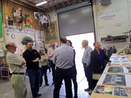 Brad Shelton, second from left, a set designer for Tuacahn, leads a tour of the set design shop at the amphitheater in Ivins City.
