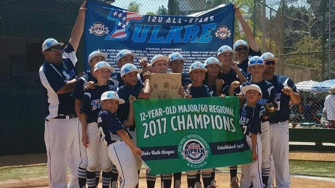 The Tulare All-Stars baseball team celebrates its 12-and-under/60 Cal Ripken Pacific Southwest Regional championship on Saturday in Long Beach. Tulare clinched a berth in the Cal Ripken World Series.
