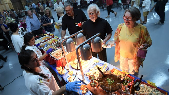 Taste of the Twin Lakes attendees visit the Letty's Mexican Restaurant booth Tuesday night. The Gassville restaurant took home first place awards for Best Casual Appetizer and Best Casual Dessert as well as the award for the best-looking booth.