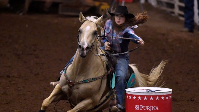 Hannah Hammond of Abilene competes in barrel racing Saturday at the Texas High School Rodeo Association Finals Rodeo at the Taylor County Coliseum. Hammond ranked sixth in the event.