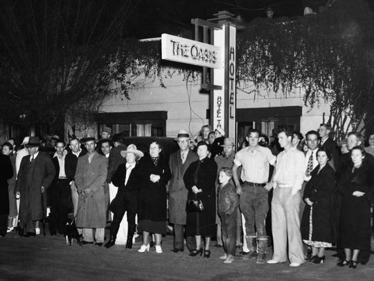 """Onlookers across the street in front of the Oasis Hotel for movie premiere of """"Camille"""" at Plaza Theatre in Palm Springs on Dec. 12, 1936."""