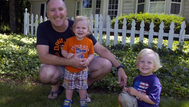 The Bird family home on Alameda is set to undergo $100,000 worth of exterior renovations thanks to the CertainTeed $100,000 Living Spaces Facebook Home Makeover Contest. Pictured here are Lee Bird with sons Leo, 1, and Max, 3.