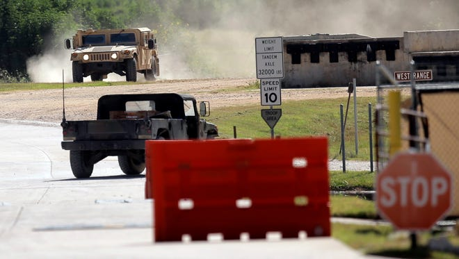 Military vehicles are seen at Texas Army National Guard Camp Swift on July 15, 2015, in Bastrop, Texas.