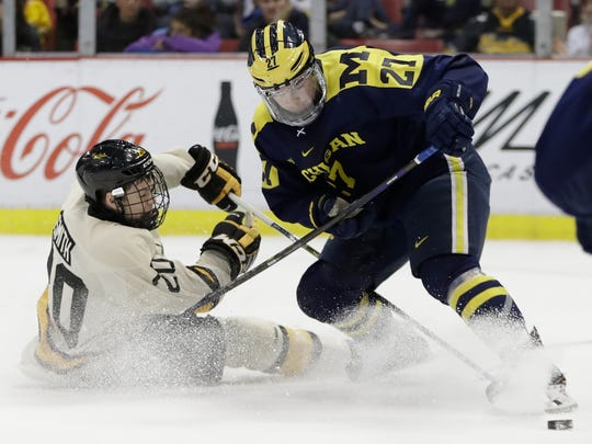 Nick Boka, right, completed a four-year collegiate career at the University of Michigan, helping the Wolverines to two NCAA tournament appearances and the Frozen Four in 2018.
