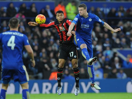 Leicester's Robert Huth, right, and Bournemouth's Joshua King battle for the ball during the English Premier League soccer match between Leicester City and Bournemouth at the King Power Stadium in Leicester, England, Saturday, Jan. 2, 2016. (AP Photo/Rui Vieira)