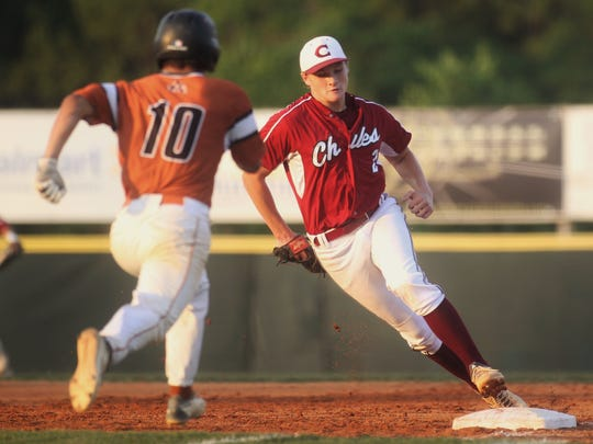 Chiles first baseman Ben Anderson fields a ground ball and races to first to get the force out during a Region 1-8A quarterfinal against Atlantic Coast.