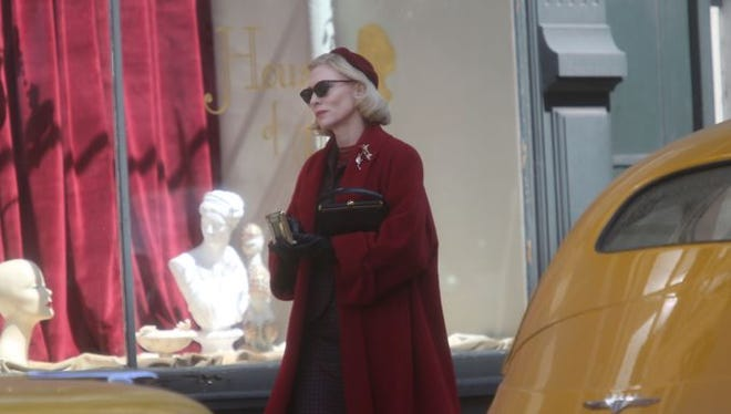 "Oscar-winning actress Cate Blanchett walks down Fourth Street during the filming of the movie ""Carol."""