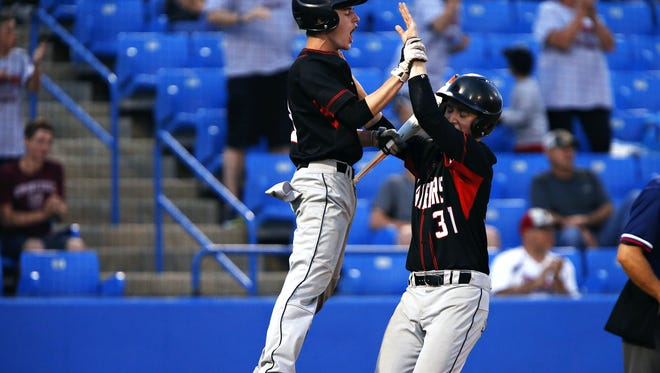 New Covenant Academy teammates Noah Phipps (3) and Matt Searson (31) celebrate after both were driven in by Josh Isbell (not pictured) double during the fifth inning Wednesday 4-2 win over Hurley at U.S. Baseball Park.