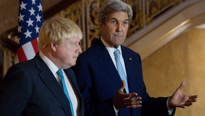 British Foreign Secretary Boris Johnson, left, and U.S .Secretary of State John Kerry give a joint news conference in London on Oct. 16, 2016.