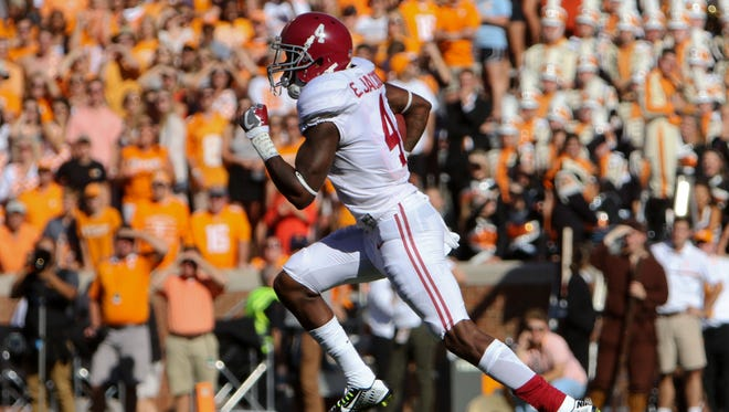 Alabama's Eddie Jackson (4) returns a kick for a touchdown in the Crimson Tide's rout of Tennesee on Saturday in Knoxville.