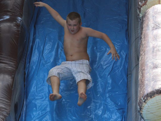 Water slides were some of the new features at Saturday in the Park for the festival's 20th anniversary. Local children seemed to enjoy cooling off on a hot day.