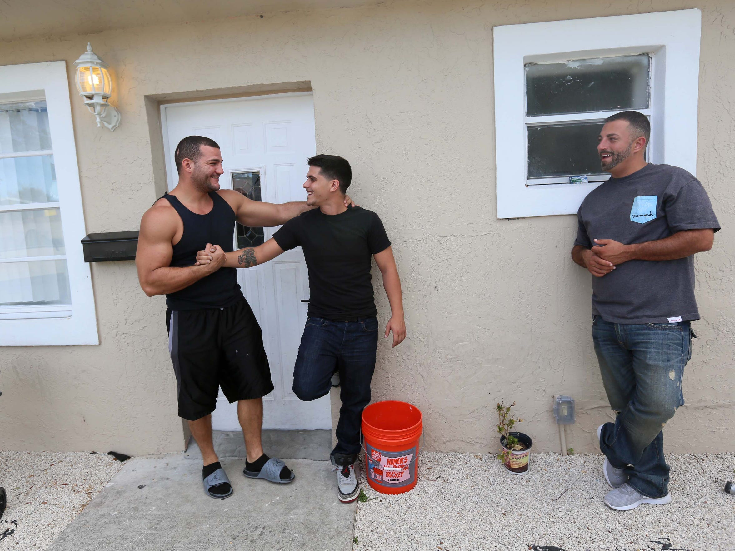 Recovery housemate Brandon Pirrone (left) shakes hands