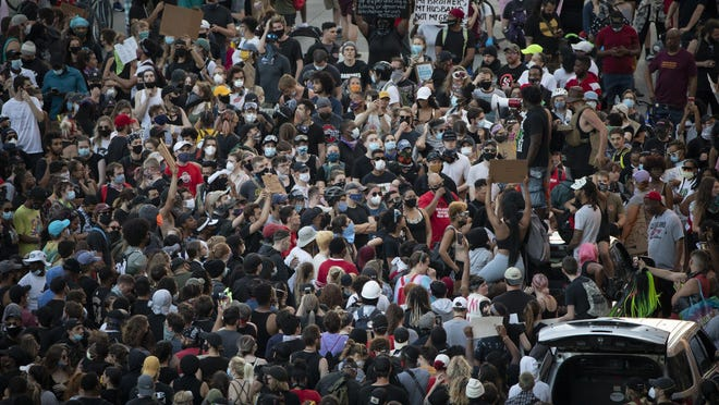 A large crowd filled the intersection of Broad and High streets on Tuesday for a  peaceful protest of what protesters see as systemic racism in police departments.