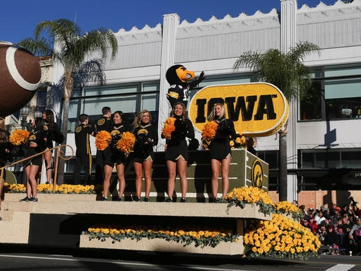 Members of the University of Iowa Spirit Squad greet