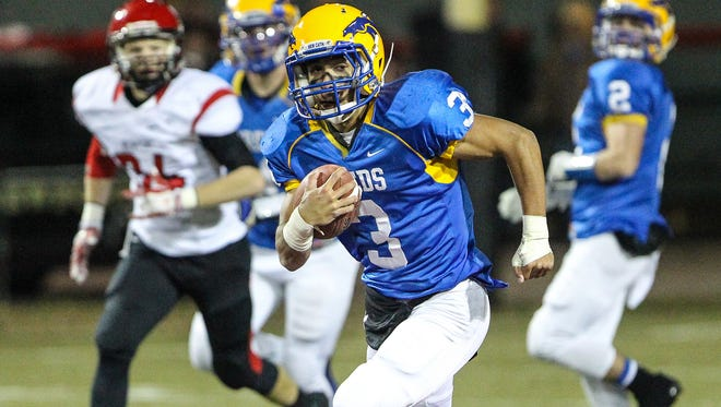 NewCath's Jacob Smith breaks a long touchdown run to give his team a 24-3 lead shortly before halftime against Newport.