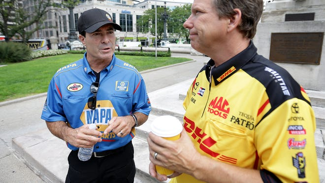 Funny Car drivers Ron Capps, left, and Del Worsham, talked before a program Wednesday on Monument Circle to promote the 62nd Annual Chevrolet Performance U.S. Nationals through Sept. 5 at Lucas Oil Raceway.