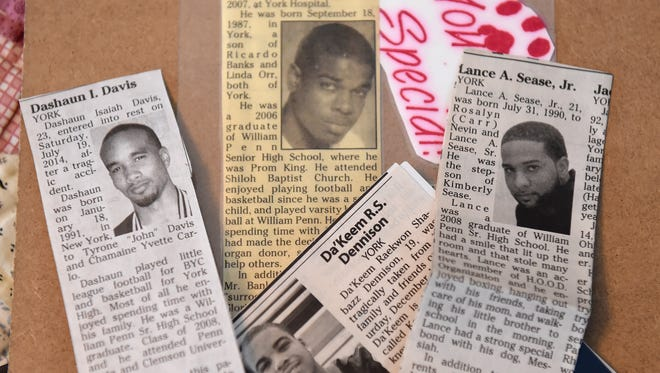 Former guidance counselor John Moroney keeps obits of William Penn High School students he helped in the past.