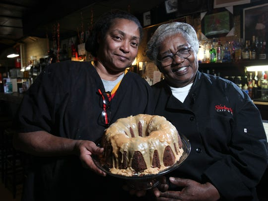 Shirley Mae Beard, right, with her daughter Theresa Simpson as they hold Shirley Mae's Jam Cake at the Shirley Mae's Cafe.