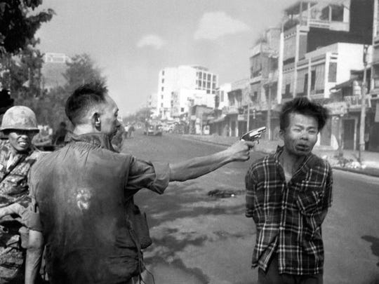 Gen. Nguyen Ngoc Loan, chief of the South Vietnamese National Police, prepares to execute suspected Viet Cong officer Nguyen Van Lem, also known as Bay Lop,  on a Saigon street Feb.1, 1968, early in the Tet Offensive.