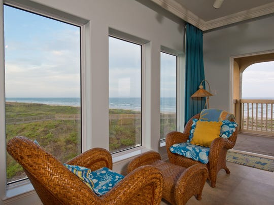 A seating area in the master suite offers spectacular views of the dunes, beach and Gulf of Mexico.