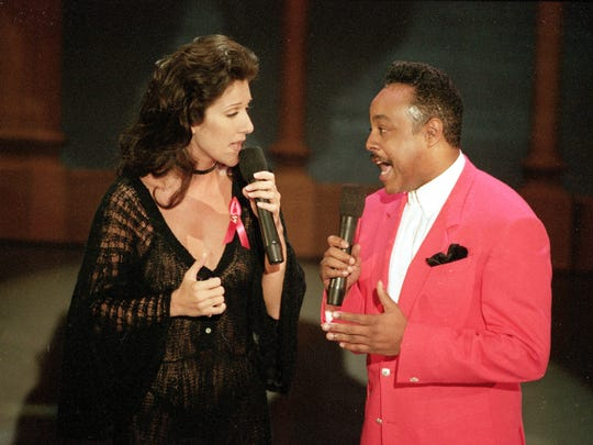 "Celine Dion and Peabo Bryson perform the song ""Beauty and the Beast,"" that won them the Grammy for Best Pop Vocal Perfomance by a Group or Duo, at the 35th annual Grammy Awards."