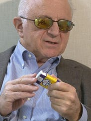 Paul Ressler is shown with an Evzio Naloxone HCI injector
