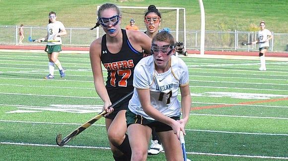 Lakeland's Julianna Cappello moves ball up the sideline last October as she's pursued by Mamaroneck's Katherine LoBue..