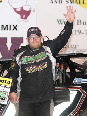 Matt Ryan of Davenport gives a wave to the fans after winning the  late model feature at 34 Raceway Saturday on High Five for Kids Night. Ryan made history being the first driver to win both, the Slocum 50 and High For Kids Night races in the same year.