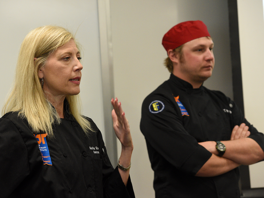 Instructor Holly Knowling, left, and Tyler White talk to a Pellissippi State culinary class on June 5, 2015. Knowling reported that tenured professor Tom Gaddis subjected her to unwanted hugs, uncomfortable comments and unsolicited conversations about how often two people should have sex to maintain a healthy relationship.
