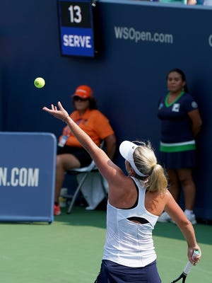 """CoCo Vandeweghe makes a serve as the new """"serve clock,""""  or """"shot clock"""" counts between the end of points and the next serve during the Western and Southern Open at the Lindner Family Tennis Center in Mason Monday, August 13, 2018."""