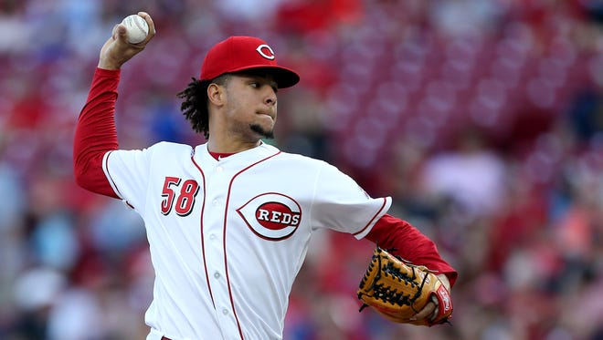 Cincinnati Reds starting pitcher Luis Castillo (58) delivers in the second inning during a National League baseball game between the New York Mets and the Cincinnati Reds, Tuesday, May 8, 2018, at Great American Ball Park in Cincinnati.