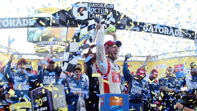 Dale Earnhardt Jr. celebrates his first win at Martinsville Speedway.